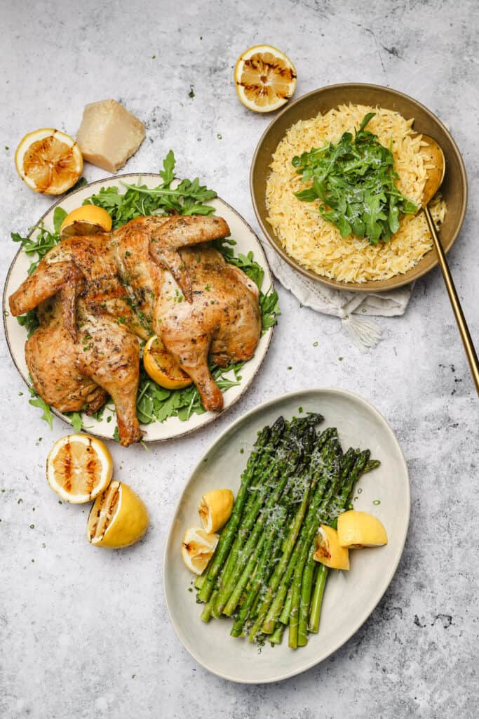 Grilled spatchcock chicken with asparagus and orzo