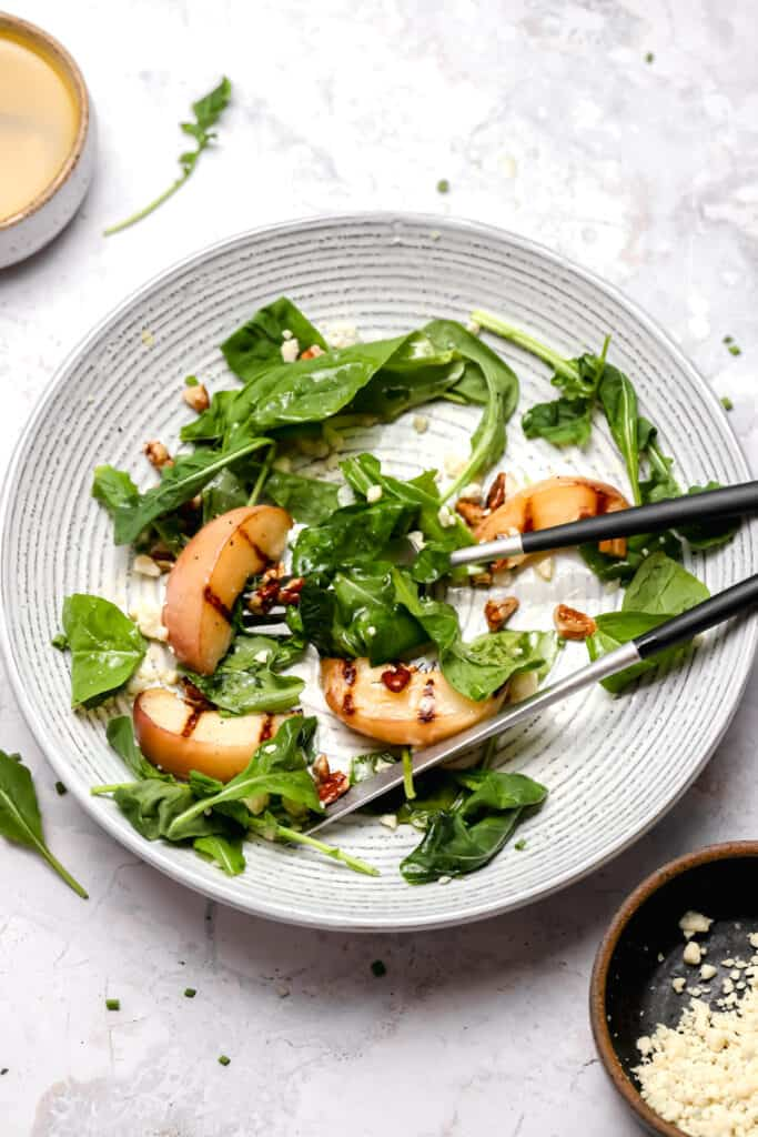 Arugula salad with grilled peachs and pecans