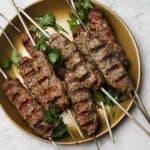 Beef kebab skewers on a plate