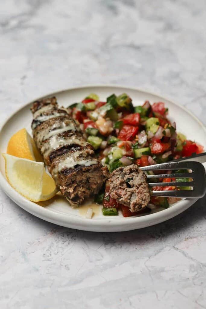 Beef kebab with tahini and Arab salad