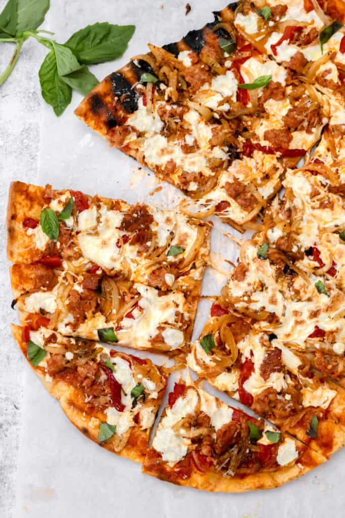 Cheesy grilled sausage pizza