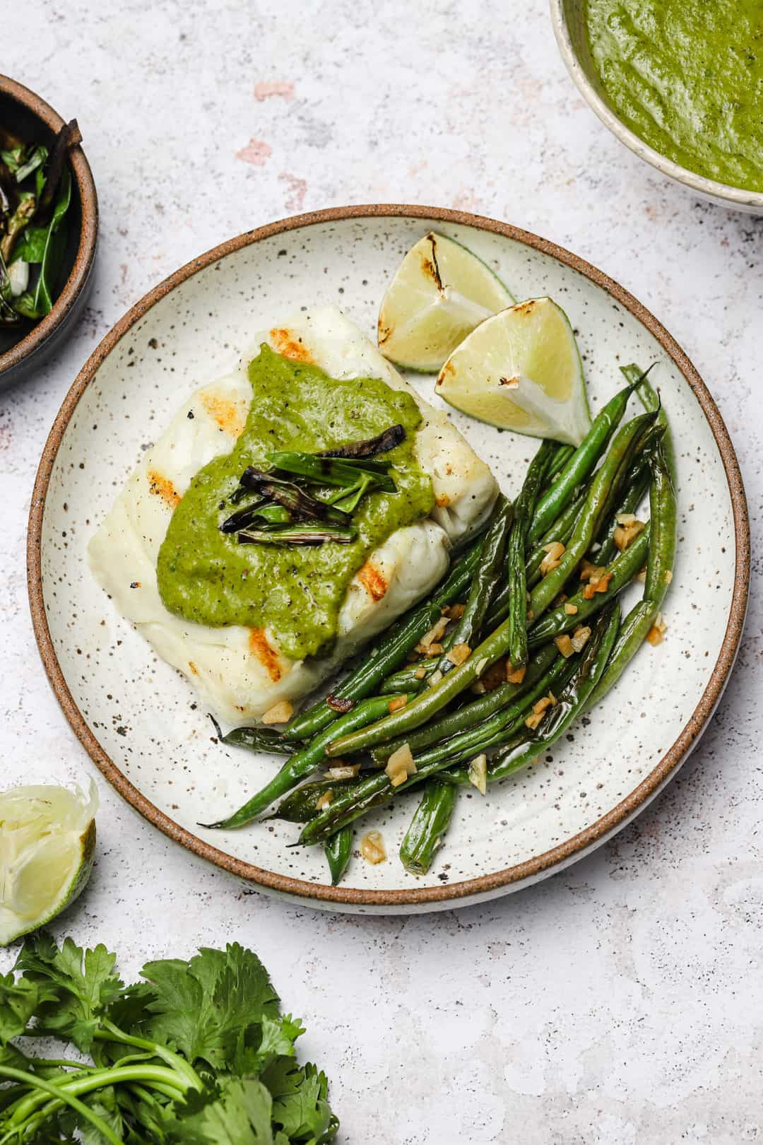 Grilled halibut fillet with scallions