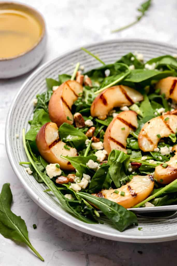 Grilled peach salad with blue cheese and pecans