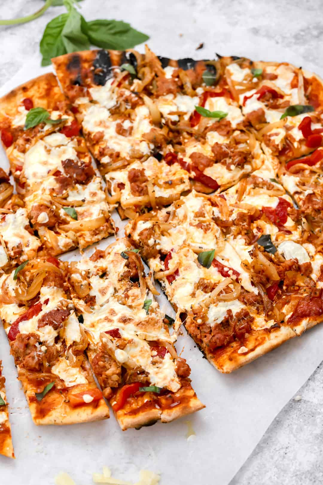 Grilled pizza with sausage fennel and onions