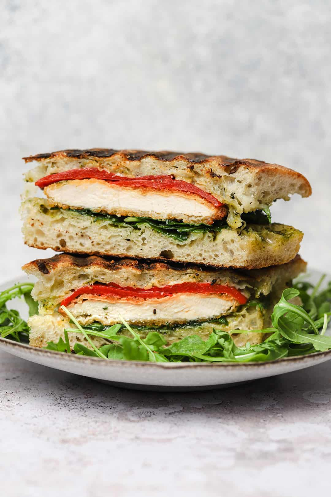 Chicken pesto panini with roasted red peppers on focaccia