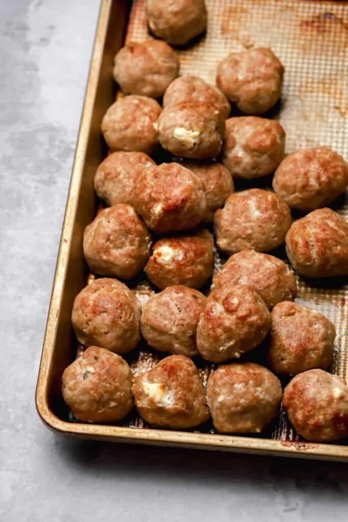 Greek turkey meatballs on a baking sheet