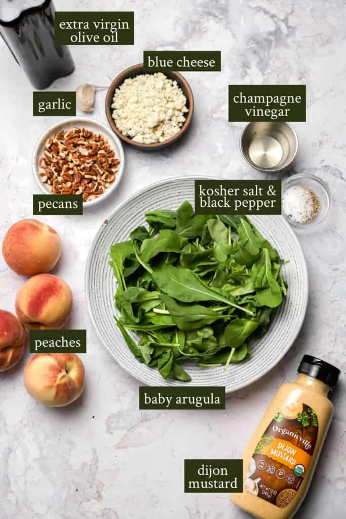 Ingredients for peach and arugula salad