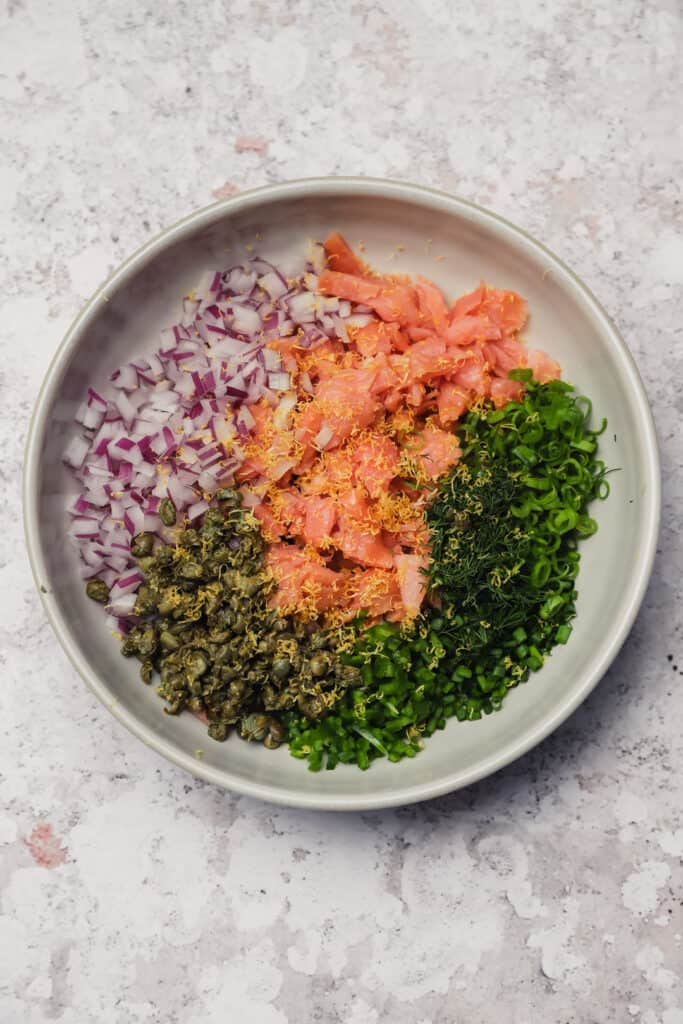 Cold smoked salmon with onion and capers