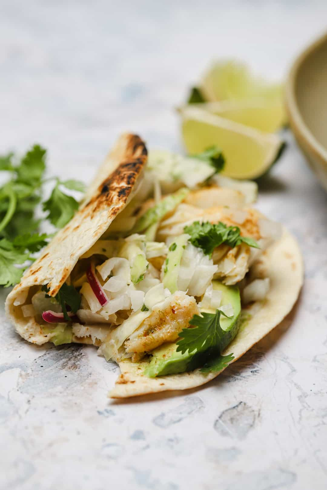 Grilled fish tacos with cabbage slaw and cilantro