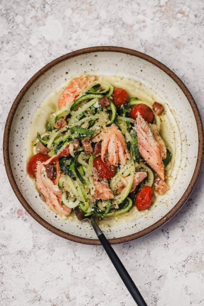 Pesto zoodles with blustered tomatoes, salmon, and pacnetta
