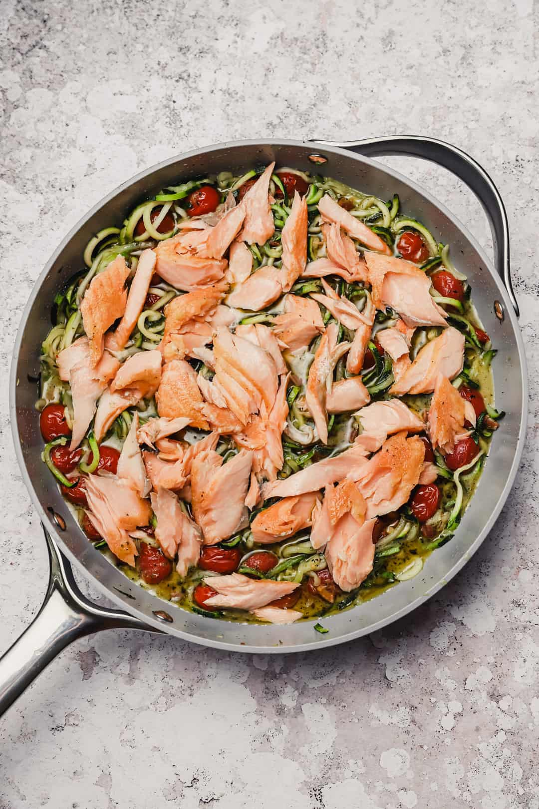 Pesto zoodles with salmon and blistered tomatoes