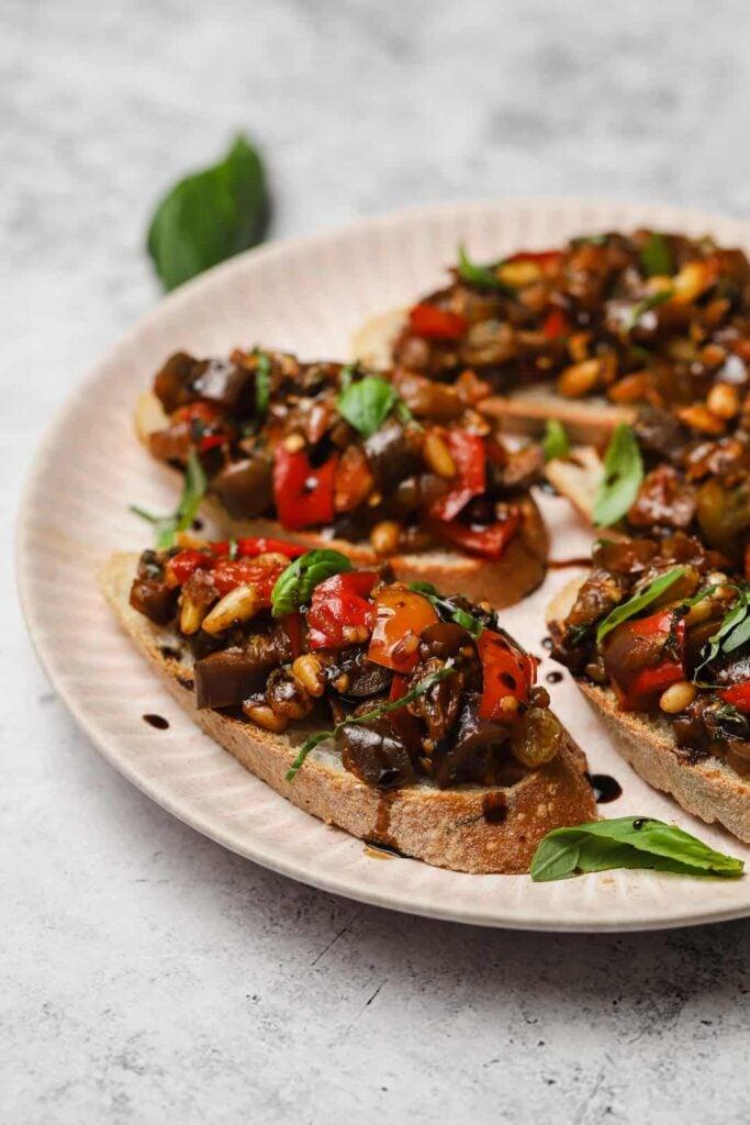 Homemade caponata crostini with basil