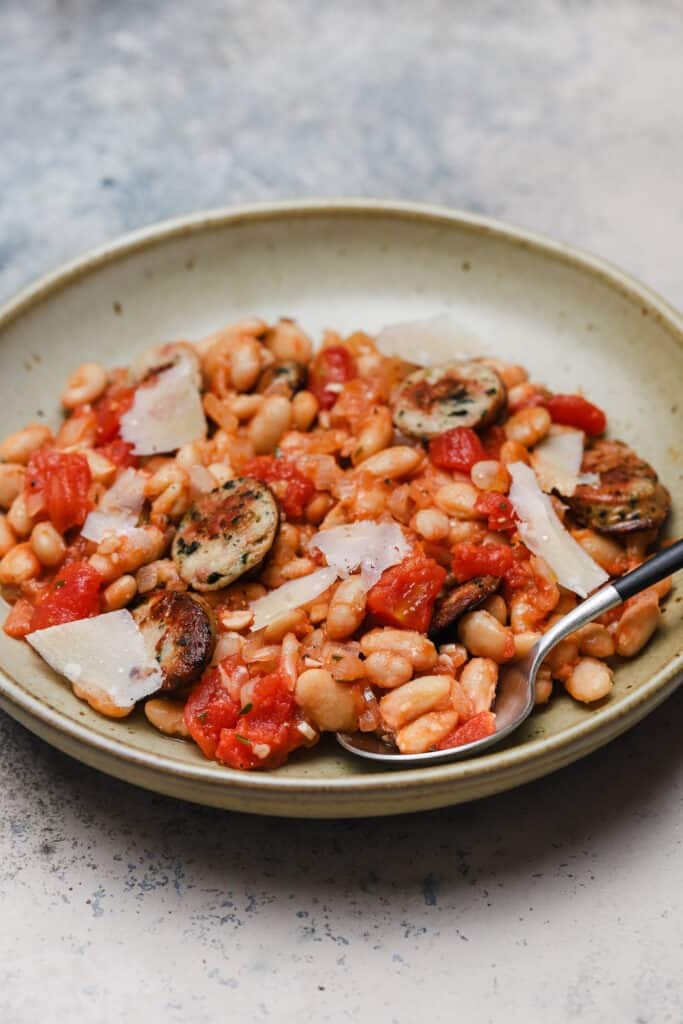Spicy white beans with chicken sausage and Parmesan