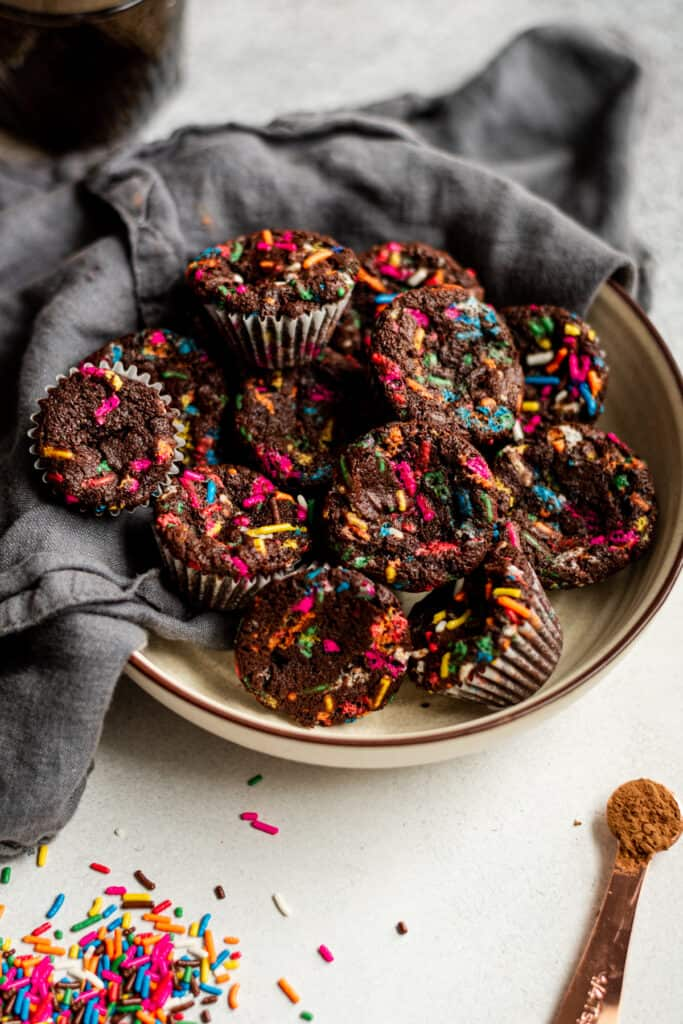 Chocolate muffins with rainbow sprinkles in a bowl