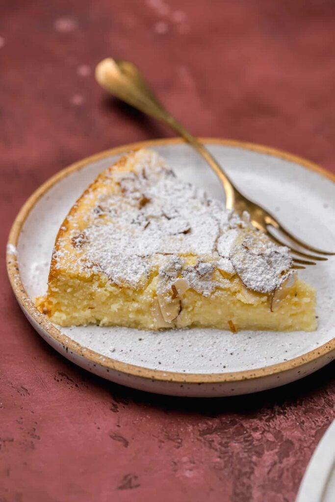 Slice of almond ricotta cake on a plate